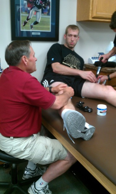 Former Pacers trainer David Craig working on former Purdue star Rob Hummel the summer before Hummel's first pro season.
