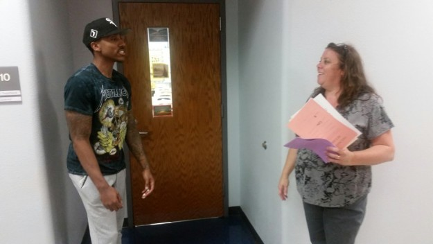 Jeff Teague talks with his favorite former Geometry teacher at Pike High School, Miss Guimond. He hated the class. She promised to get him a girlfriend if he got a good grade. He got a B. She told him he didn't need help, he was a basketball star.