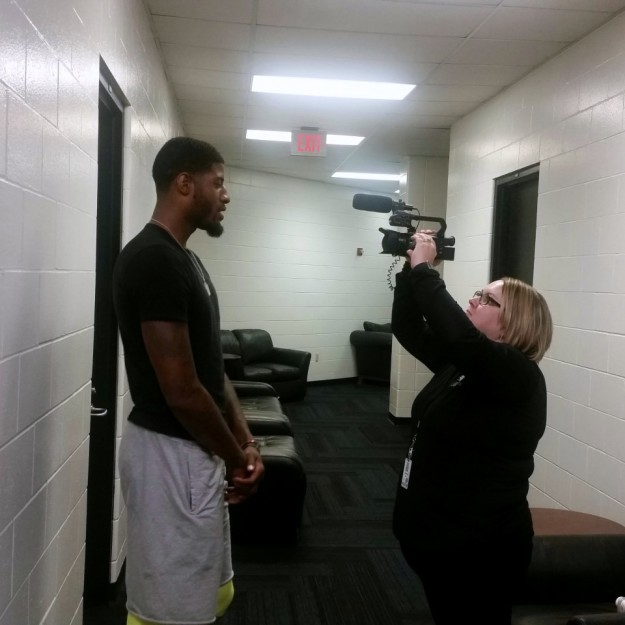 Paul George recording a message for Tamika Catchings two days before her final game with the Fever. Celeste Bayou works the camera.