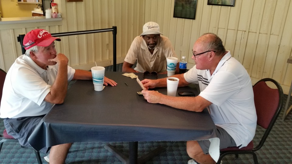 Billy Shepherd, Darnell Hillman and Billy Keller check the scores after a round of golf at Bear Slide. Shepherd won all the money.